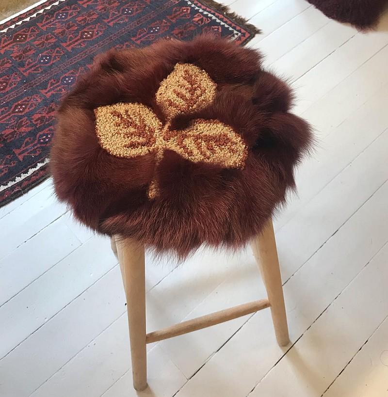 Sædebetræk i pels og tufted garn
